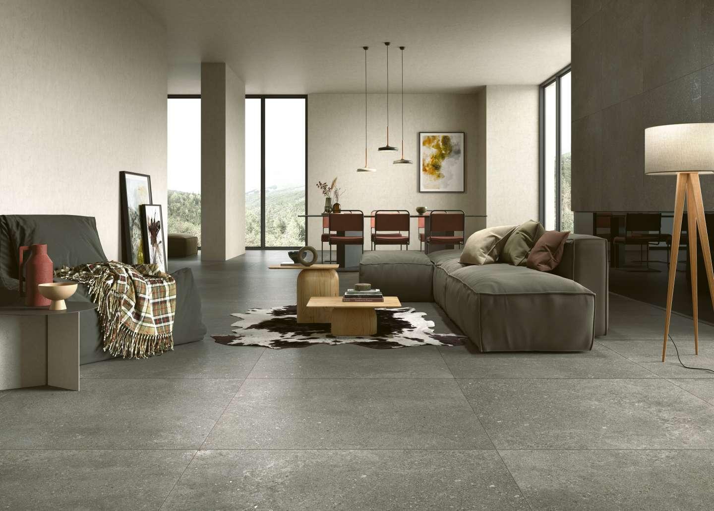 graue Steinoptik Fliesen im Wohnzimmer, grey sone effect tiles in the living room